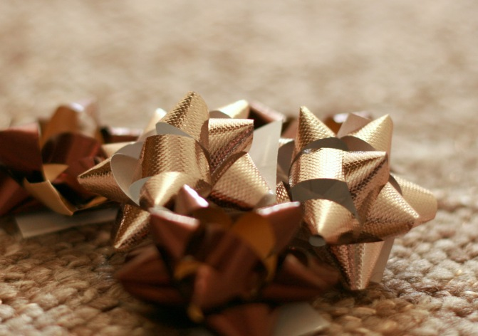 close up gold gift bows
