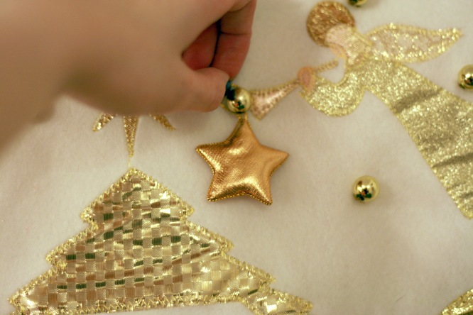 putting the star on a felt advent calendar